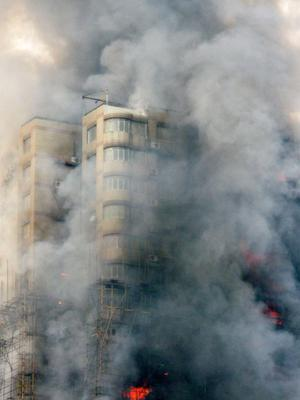 In this citizen journalism photo acquired by the Associated Press an apartment building is on fire in the downtown area of Shanghai, east China, on Monday Nov. 15, 2010.  Fire engulfed the high-rise apartment building under renovation in China's business center of Shanghai on Monday, killing at least eight people, injuring more than 90 and sending some residents scattering down scaffolding to escape.  (AP Photo/Karl Loo)