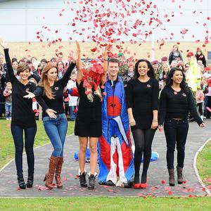 The Saturdays with band major Alastair McCartney at the launch the 2010 Royal British Legion Poppy Appeal