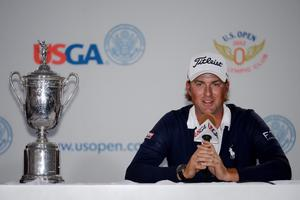 SAN FRANCISCO, CA - JUNE 17:  Webb Simpson of the United States addresses the media with the trophy after his one-stroke victory at the 112th U.S. Open at The Olympic Club on June 17, 2012 in San Francisco, California.  (Photo by Harry How/Getty Images)