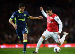 LONDON, ENGLAND - APRIL 16:  Andre Santos of Arsenal and Franco Di Santo of Wigan battle for the ball during the Barclays Premier League match between Arsenal and Wigan Athletic at Emirates Stadium on April 16, 2012 in London, England.  (Photo by Laurence Griffiths/Getty Images)