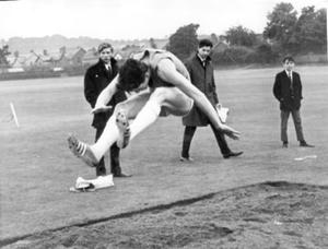 Seventeen year old Ken Nicholls competing in the open long jump event at the Methodist College Centenary Sports held at Pirrie Park, Belfast, 1968.