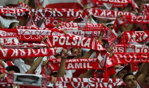 WARSAW, POLAND - JUNE 12:  The Polish fans enjoy the atmosphere during the UEFA EURO 2012 group A match between Poland and Russia at The National Stadium on June 12, 2012 in Warsaw, Poland.  (Photo by Alex Grimm/Getty Images)