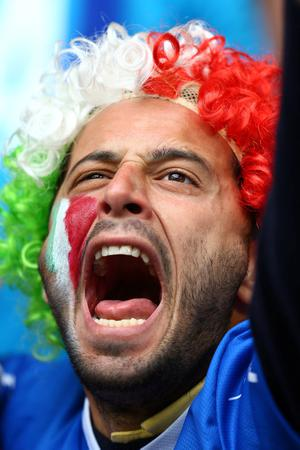 POZNAN, POLAND - JUNE 14: An Italy fan enjoys the  atmopshere during the UEFA EURO 2012 group C match between Italy and Croatia at The Municipal Stadium on June 14, 2012 in Poznan, Poland.  (Photo by Clive Mason/Getty Images)