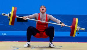 LONDON, ENGLAND - AUGUST 01:  Hassine Ghada of Tunisia competes in the Women's 69kg Weightlifting on Day 5 of the London 2012 Olympic Games at  ExCeL on August 1, 2012 in London, England.  (Photo by Laurence Griffiths/Getty Images)