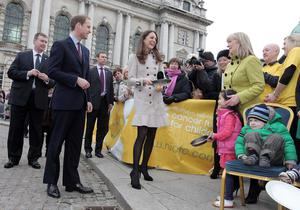 ©Jonathan Porter/Presseye.com - Press Eye Ltd -Northern Ireland -  8th March 2011.  Prince William  and his future wife Kate Middleton make their first official visit to Northern Ireland.  The Royal couple pictured starting their visit at Belfast's City Hall and toss some pancakes for the Northern Ireland Cancer Fund for Children.  Charlie McCrea(3 & right) from Belfast who has leukemia and Ellie Tang(6 & second from right) from Ballymena whose brother has cancer look on as Miss Middleton tosses a pancake.  The Prince is set to marry Miss Middleton in April.