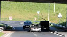 Vehicles  drove past the suspect device yesterday after cones blocking the road were removed
