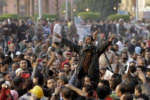 Egyptian proteters shout anti ruling military  council at Tahrir Square, the focal point of the recent Egyptian uprising in Cairo, Egypt, Monday, Nov. 21, 2011.   Security forces fired tear gas and clashed Monday with several thousand protesters in Cairo's Tahrir Square in a sustained challenge to the rule of Egypt's military regime. (AP Photo/Amr Nabil)
