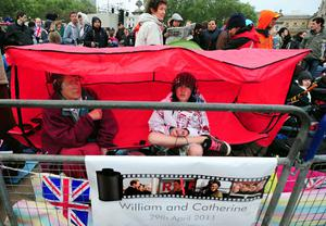 People (names not known) gather outside Buckingham Palace, London, on the morning of the royal wedding
