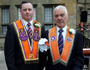Worshipful District Master David Martin (left) presents Derek McBride of Lurgan Purple Star LOL 63 with his fifty year jewel before the Twelfth parade through Lurgan. Picture By Rick Hewitt. 12/7/11.