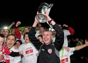 Derry City manager Stephen Kenny lifts the Division 1 trophy