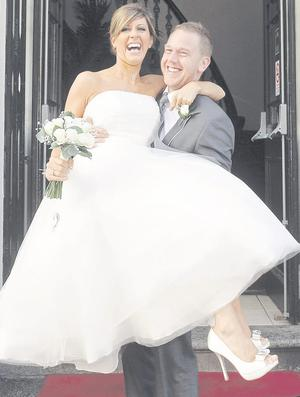 "Andrew Armstrong with his wife Stephanie after they were married at Belfast City Hall. <p><b>To send us your Wedding Pics <a  href=""http://www.belfasttelegraph.co.uk/usersubmission/the-belfast-telegraph-wants-to-hear-from-you-13927437.html"" title=""Click here to send your pics to Belfast Telegraph"">Click here</a> </a></p></b>"