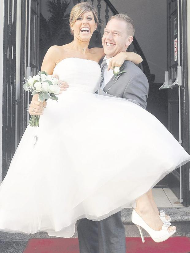 """Andrew Armstrong with his wife Stephanie after they were married at Belfast City Hall. <p><b>To send us your Wedding Pics <a  href=""""http://www.belfasttelegraph.co.uk/usersubmission/the-belfast-telegraph-wants-to-hear-from-you-13927437.html"""" title=""""Click here to send your pics to Belfast Telegraph"""">Click here</a> </a></p></b>"""
