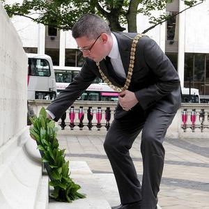 Belfast mayor Niall O Donnghaile lays a wreath at the Somme memorial