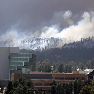 Officials at the Los Alamos National Lab insist their nuclear facilities have not been damaged by the wildfire (AP)