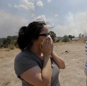 Residents lie in fear of the presence of radiation from the Los Alamos nuclear laboratory amid the wildfire smoke (AP)