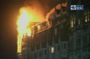 Flames erupt from the Taj Mahal hotel in Mumbai, India in this image made from television, Wednesday, Nov. 26, 2008. Teams of heavily armed gunmen stormed luxury hotels, a popular restaurant and a crowded train station in coordinated attacks across India's financial capital Wednesday night, killing at least 78 people and taking Westerners hostage, police said. A previously unknown group, apparently Muslim militants, took responsibility for the attacks. A raging fire and explosions struck one of the hotels, the landmark Taj Mahal, early Thursday.  (AP Photo/STAR NEWS)  **  INDIA OUT  TV OUT  **