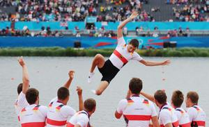 WINDSOR, ENGLAND - AUGUST 01:  The Germany team throw their cox Martin Sauer into the water after winning gold in the Men's Eight Final on Day 5 of the London 2012 Olympic Games at Eton Dorney on August 1, 2012 in Windsor, England.  (Photo by Mike Hewitt/Getty Images)