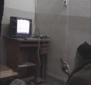 Bin Laden watches himself on TV from his terror lair