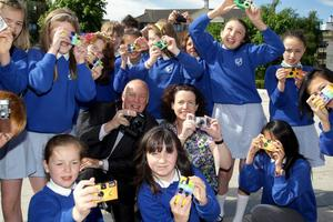 Launching the Belfast Telegraph's/Northern Irealnd Tourist Board's biggest ever mass participation Photographic Competition called One Summer's Day are Belfast Telegraph Picture Editor Gerry FitzGerald and Pauline Gormley from the Northern Ireland Tourist Board with the pupils from St. Josephs Primary School Ballyhackamore.