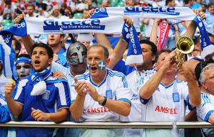 WROCLAW, POLAND - JUNE 12:  Greek fans soak up the atmosphere during the UEFA EURO 2012 group A match between Greece and Czech Republic at The Municipal Stadium on June 12, 2012 in Wroclaw, Poland  (Photo by Christof Koepsel/Getty Images)
