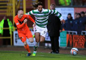 Celtic's Giorgios Samaras and Dundee United's Willo Flood battle for possession yesterday