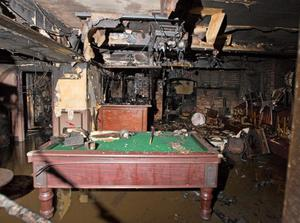 The charred remains of McCoy's Bar at Kilmorey Street in Newry after an arson attack over the weekend