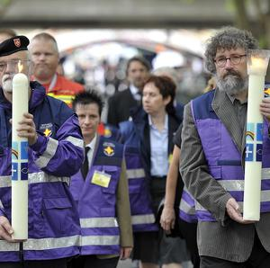 Rescue helpers candles to the Salvator church in Duisburg as part of memorial for Love Parade victims. (AP)