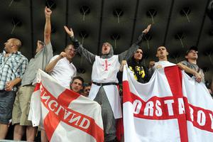 England fans celebrate victory in the stands after the final whistle during the UEFA Euro 2012 Group D match at the Olympic Stadium, Kyiv, Ukraine. PRESS ASSOCIATION Photo. Picture date: Friday June 15, 2012. See PA Story SOCCER England. Photo credit should read: Anthony Devlin/PA Wire. RESTRICTIONS: Use subject to restrictions. Editorial use only. Book sales permitted providing not solely devoted to any one team / player / match. No commercial use. Call +44 (0)1158 447447 for further information.