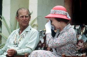 26/10/1982 Queen Elizabeth II and the Duke of Edinburgh taking photographs during their visit to the South Sea Islands of Tuvalu. PRESS ASSOCIATION Photo.