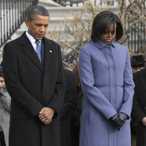 President Barack Obama and First Lady Michelle Obama lead a moment of silence for the victims of the Arizona shooting (AP)