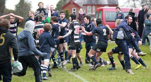 Methodist College players celebrate their last gasp victory over Wallace High on Saturday to keep their Schools' Cup dream alive.
