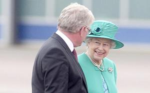 Queen Elizabeth II is greeted by Tanaiste Eamon Gilmore upon arrival at Casement Aerodrome, Baldonnel