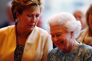 Queen Elizabeth II (R) and Irish President Mary McAleese listen to live classical music as they arrive at the Convention Centre Dublin for an evening of British and Irish music and fashion on May 19, 2011 in Dublin, Ireland.  (Photo by Oli Scarff/Getty Images)
