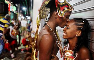 SALVADOR, BRAZIL - FEBRUARY 16:  A couple kiss before performing on the first day of Carnival celebrations on February 16, 2012 in Salvador, Brazil. Carnival is the grandest holiday in Brazil, annually drawing millions in raucous celebrations culminating on Fat Tuesday before the start of the Catholic season of Lent which begins on Ash Wednesday. Salvador is the capital of the Northeastern state of Bahia and was the first colonial capital of Brazil. Police strikes in Salvador and Rio de Janiero in recent weeks threatened Carnival and raised questions about the countryÄôs preparedness to host the upcoming 2014 World Cup and 2016 Summer Olympics. Rio de JaneiroÄôs Carnival begins tomorrow.   (Photo by Mario Tama/Getty Images)