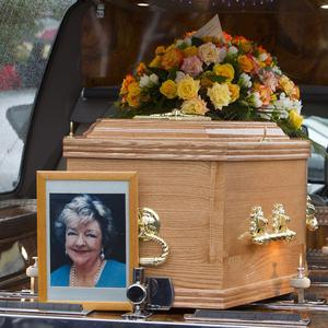 A picture of Maeve Binchy, sits at the head of her coffin, following her funeral in Dalkey, south Dublin