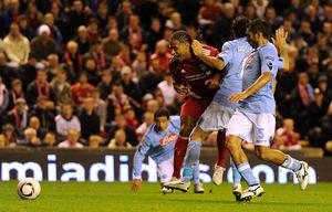 Liverpool's Glen Johnson (centre) is fouled by Napoli's Salvatore Aronica, resulting in a penalty during the UEFA Europa League match at Anfield, Liverpool. PRESS ASSOCIATION Photo. Picture date: Thursday November 4, 2010. Photo credit should read: Martin Rickett/PA Wire.