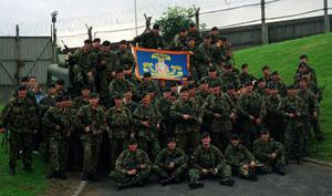 RIR Support The Orangemen At Drumcree January 2000. Members of the Royal Irish Regiment with a flag supporting Orangemen in Drumcree.
