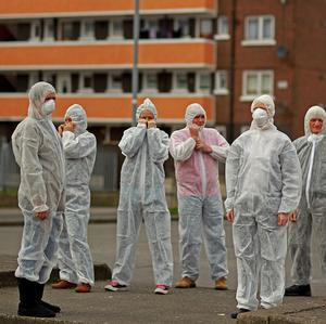 Residents of Dolphin House protest dressed in biohazard suits to illustrate the problems with damp at the estate last year
