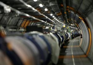 View of the LHC (large hadron collider) in its tunnel at CERN (European particle physics laboratory) near Geneva, Switzerland, Thursday, May 31, 2007. The LHC is a 27-kilometre-long underground ring of superconducting magnets housed in this pipe-like structure or cryostat. The cryostat is cooled by liquid helium to keep it at an operating temperature just above absolute zero. It will accelerate two counter-rotating beam of protons to an energy of 7 tera electron volts (TeV) and then bring them to collide head on. Several detectors are being built around the LHC to detect the various particles produced by the collision. A pilot run of the LHC is scheduled for summer 2007. (KEYSTONE/Martial Trezzini)