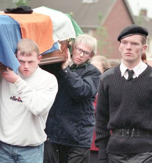 Alan Lewis - Photopress Belfast     11-10-2009    STOCKHugh Torney (rear of coffin) INLA leader pictured in disguise wearing a blonde wig and glasses at an INLA funeral in Belfast on 5/4/95.Torney was shot dead the following year in Lurgan, County Armagh.Today the INLA announced in Wicklow that the organisation is 'renouncing' violence.