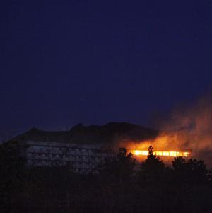 The Inter Continental hotel on fire during an attack in Kabul, Afghanistan (AP)
