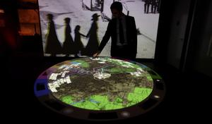 A man looks at an interactive map of the shipyard in which the Titanic was built.