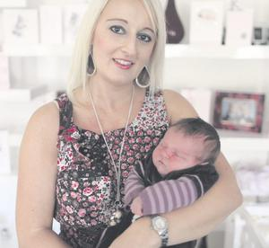 "Leanne Jordan at home with her newborn baby, Nevaeh <p><b>To send us your Baby Pics <a href=""http://www.belfasttelegraph.co.uk/usersubmission/the-belfast-telegraph-wants-to-hear-from-you-13927437.html"" title=""Click here to send your pics to Belfast Telegraph"">Click here</a> </a></p></b>"