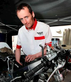 Darren Gilpin emerges from a humble background to rub shoulders with giants of the motorcycle world at the North West 200