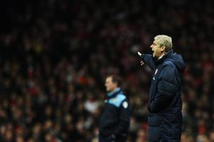 LONDON, ENGLAND - JANUARY 09:  Arsene Wenger the Arsenal manager watches from the touchline during the FA Cup Third Round match between Arsenal and Leeds United at the Emirates Stadium on January 9, 2012 in London, England.  (Photo by Clive Mason/Getty Images)