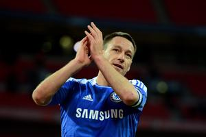LONDON, ENGLAND - APRIL 15:  John Terry of Chelsea salutes fans after victory in the FA Cup with Budweiser Semi Final match between Tottenham Hotspur and Chelsea at Wembley Stadium on April 15, 2012 in London, England.  (Photo by Mike Hewitt/Getty Images)