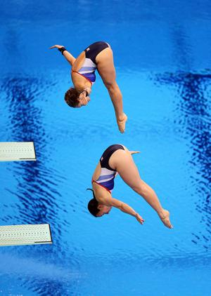 Great Britain's Rebecca Gallantree (bottom) and Alicia Blagg compete in the Women's Synchronised 3m Springboard at the Aquatics Centre, London, on the second day of the London 2012 Olympics.