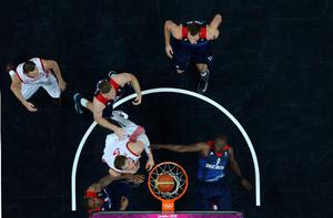Luol Deng #9 of Great Britain falls as a basket is made against Russia during their Men's Basketball Game on Day 2 of the London 2012 Olympic Games