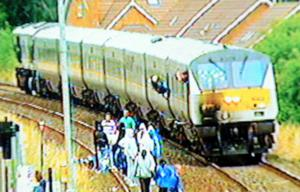 A mob surrounds the hijacked train as it leaves Lurgan station near the republican Kilwilkee area. Attempts were made to burn the train after a mob boarded the Enterprise from Belfast to Dublin