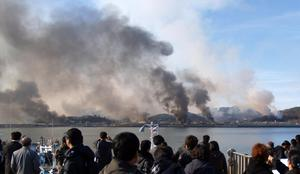 South Korean villagers watch smoke from South Korea's Yeonpyeong island near the border against North Korea Tuesday, Nov. 23, 2010. North Korea fired artillery barrages onto the South Korean island near their disputed border Tuesday, setting buildings alight and prompting South Korea to return fire and scramble fighter jets. (AP Photo/Yonhap) KOREA OUT